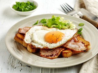 fried egg, bacon and toasted bread