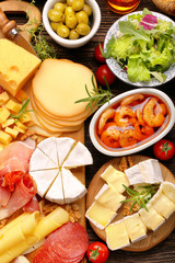 Board of various types of cheese and appetizers set