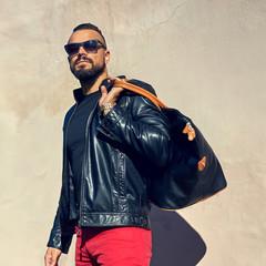 Stylish sexy man with handbag