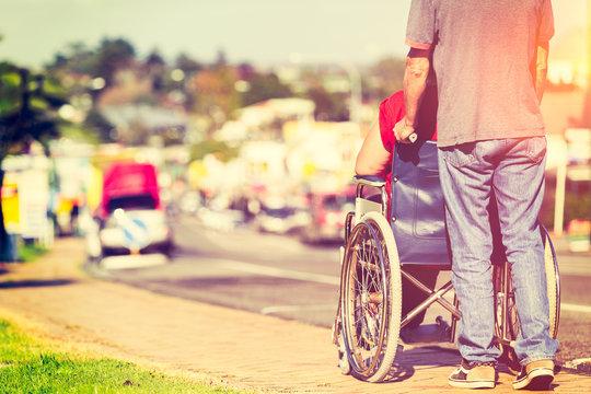 Man Pushing Wheelchair