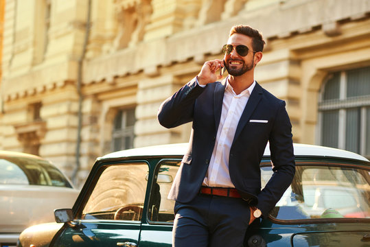 Young businessman at a car
