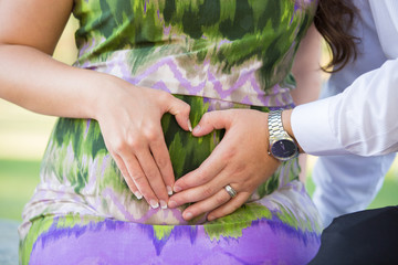 pregnant woman holding her belly. close-up