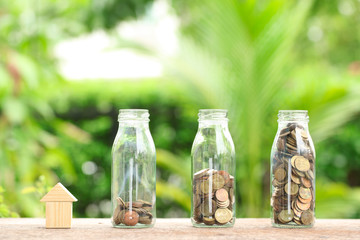 House and coins in jar. The concept of purchase of habitation, b