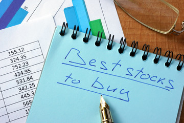 Notepad with inscription  best stocks to buy on a table.