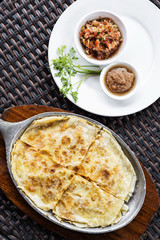 mexican cheese quesadilla with salsa and chilli sauce