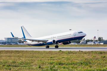 Take off passenger airplane on runway Wall mural
