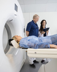 Patient Looking At Doctor's Discussing Over Computer During MRI