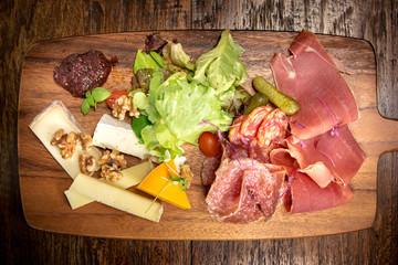 Italian salumi meat platter board  - prosciutto ham, salami and
