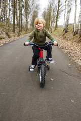 A child boy with his first bicycle