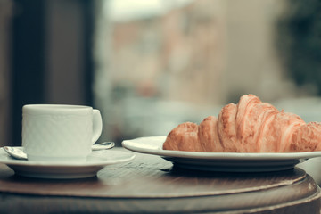 Fresh croissant and coffee cup