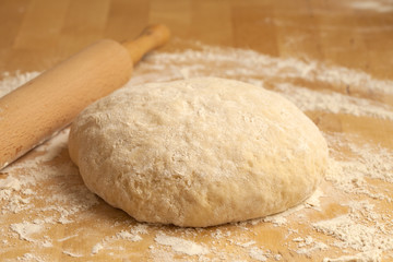 yeasty dough and rolling pin