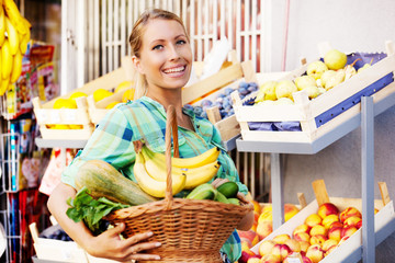 Beautiful young woman at grocery store.