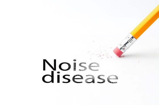 Closeup of pencil eraser and black noise disease text. Noise disease. Pencil with eraser.