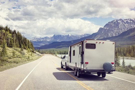 Caravan or motor home trailer on a mountain road