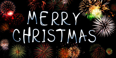 Merry christmas written with Sparkle firework. Christmas background