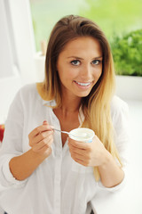 Woman with youghurt
