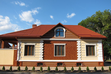 Red brick house with red roof