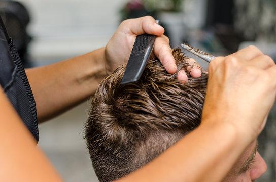 men's hair cutting scissors in a beauty salon