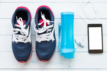 Fitness supplies on white wood