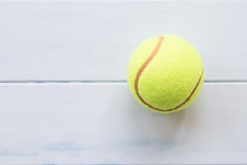 Tennis on white wood