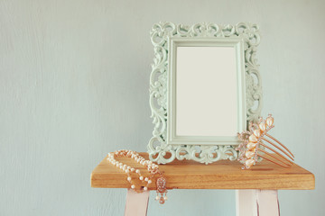 Blank victorian frame, pearls necklace and hair comb