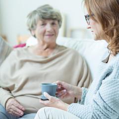Elderly woman during conversation