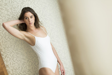 Attractive woman posing by wall