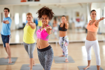 Women in fitness center keep body in condition.