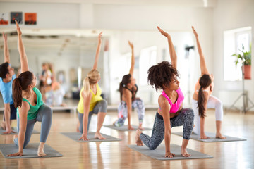 Young women practicing yoga exercises