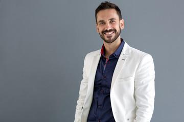 Elegant smiling male model posing