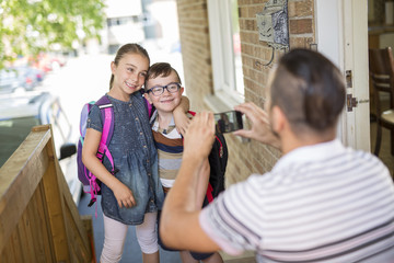 child Caucasian leaves home for his first day at preschool