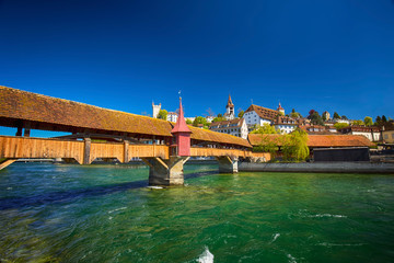 Spreuer bridge in the old city center of Luzern with the hotel chateau Guetsch in the background, Luzern, Switzerland