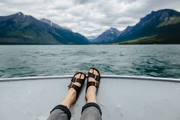 Feet and sandals on boat, Lake McDonald, Glacier National Park, Montana, Canada, United States of America , close up
