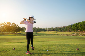 Asian woman golf hit sweeping golf course in the summer.