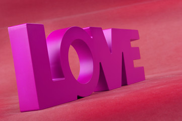 Lettering Love on red background