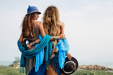 Two beautiful gypsy girls in ethnic jewelry outdoors