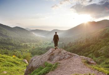 Traveler staring at the mountains.