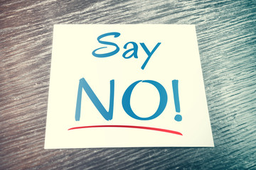 Say No Reminder On Paper Lying On Wooden Table