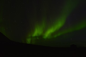 Green northern light at the most west point of the Iceland