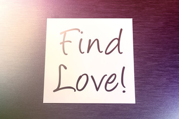 Find Love Reminder On Paper Lying On Brushed Aluminum