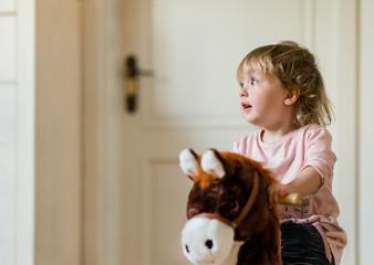 Child on rocking horse