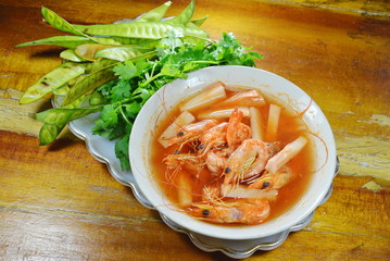 prawn with coconut shoot spicy and sour soup with fresh vegetable