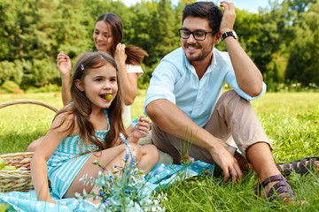 Family On Picnic. Happy Young Family Having Fun In Nature