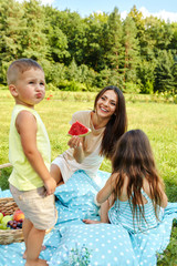 Mother With Children Having Fun In Park. Happy Family Outdoors