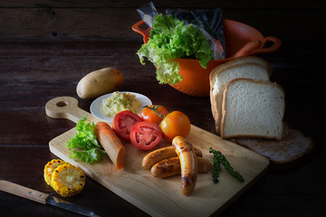 Sausage and bread with vegetables for ingredient cooking breakfa