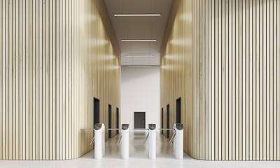 Turnstiles in office with wooden walls