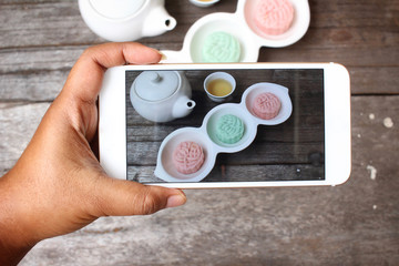 Taking a photo of mochi japanese dessert with smart phone