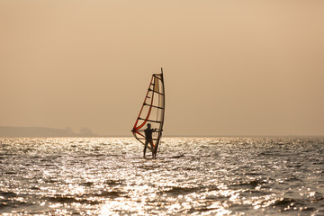 Windsurfer at the sea
