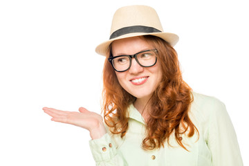 red-haired girl in a hat keeps on hand something on a white back