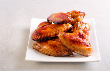 Roasted chicken wings on plate